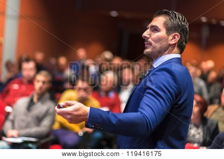 Public speaker giving talk at Business Event.