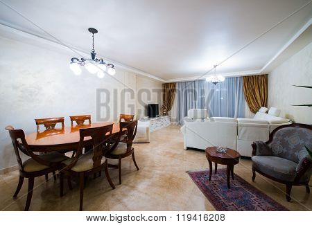 Dining area and living room in luxury apartment interior