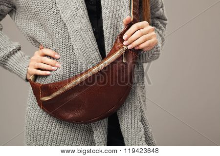 Elegant Woman With A Leather Fanny Pack.