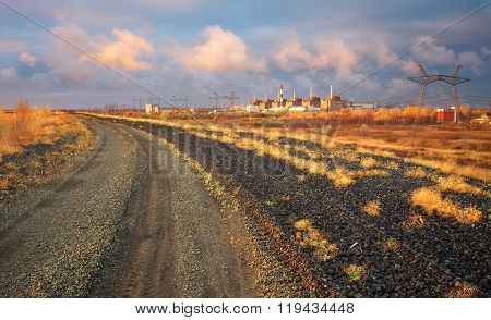Landscape with nuclear power and the road at sunrise