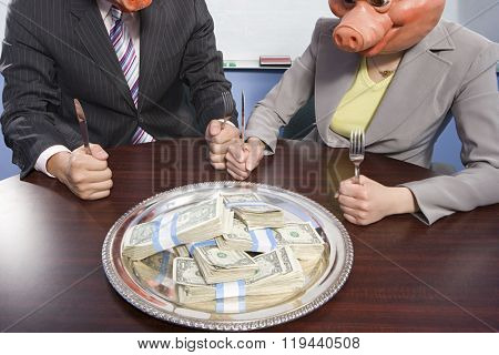 Businesspeople in pig masks sat in front of money