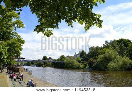 Tourists on the River Dee bank in Chester City centre