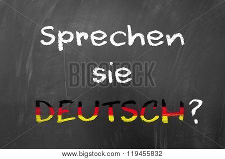 Sprechen Sie Deutsch written on the blackboard