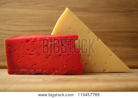 red cheese,yellow cheese,dairy product,cheese with pepper,cheese with ketchup,cheese with tomatoes,c