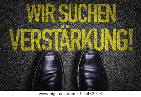 Top View of Business Shoes on the floor with the text: We Are Hiring (in German)