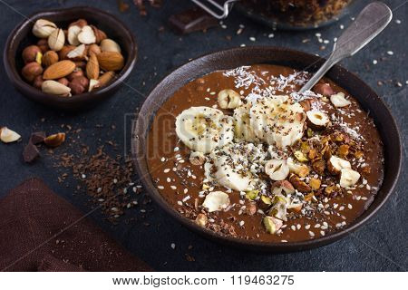 Chocolate And Banana Smoothie  Topped With Nuts And Seeds