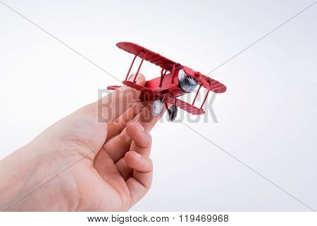 Hand Holding A Plane