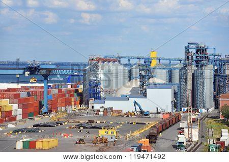 Grain dryer train and scrap metal in the port of Odessa Ukraine poster