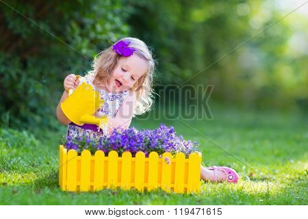 Little Girl Watering Farden Flowers