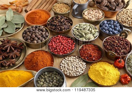 Colorful aromatic spices in bowls on the table.