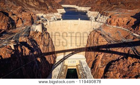 Aerial View Of Hoover Dam And Shadow Of Pat Tillman Bridge