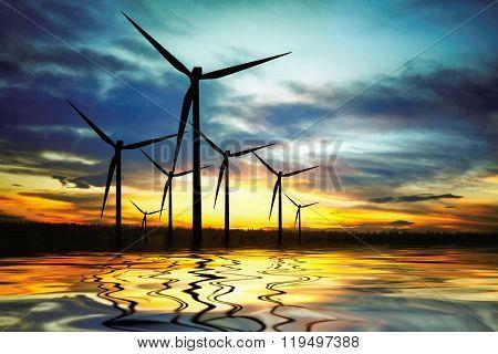 Beautiful sunset above the windmills on the lake