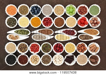 Health and diet superfood food selection in porcelain dishes over lokta paper background. High in vitamins, nutrients and antioxidants. poster