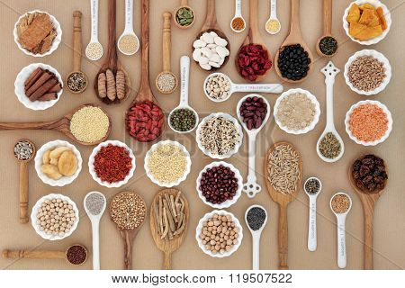 Large superfood sampler for good health in spoons and bowl forming an abstract background. Highly nutritious in antioxidants, vitamins, minerals and dietary fiber.