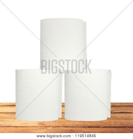 Rolls Of Toilet Paper On Wooden Table Isolated On White