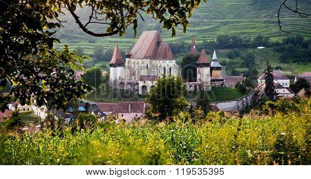 Rural landscape with medieval church, Biertan, Romannia