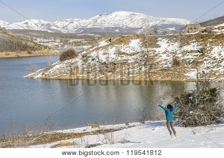 Happy Woman Jumping  In Winter Mountains In Montaña Palentina