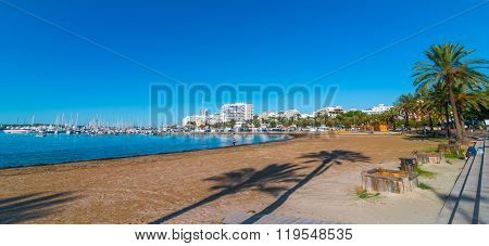 Mid morning sun on the waterfront.  Warm sunny day along the beach in Ibiza, St Antoni de Portmany B