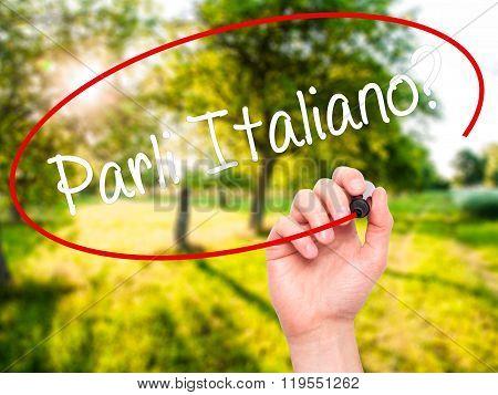 Man Hand Writing Parli Italiano? With Black Marker On Visual Screen.