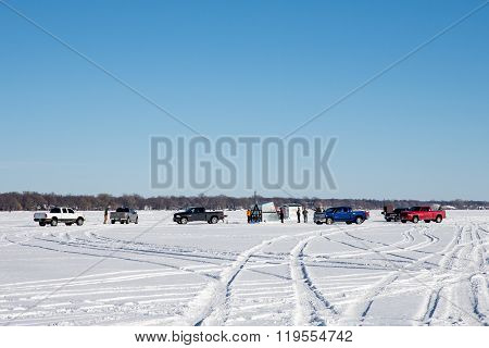 Fishermen Gathering On A Frozen Lake
