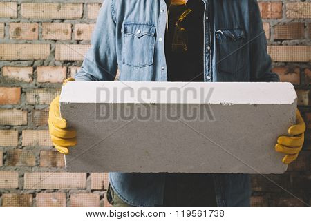 Construction worker with block