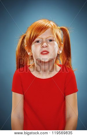 Beautiful portrait of a displeased disaffected little girl