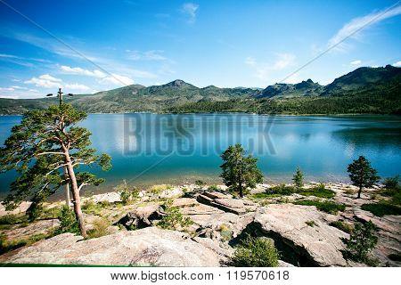 Blue lake idill under cloudline sky