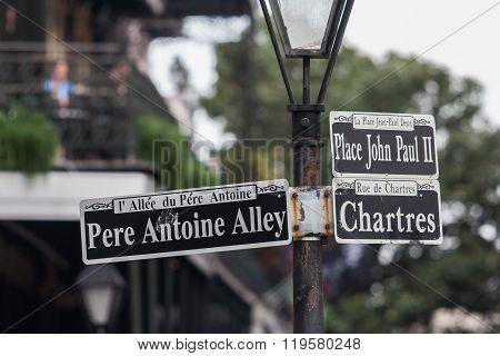 Pole With Street Signs In French Quarter, New Orleans,  Louisiana