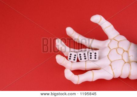 "hand of death holding three dice to reveal ""666"" part of gambling abuse series. poster"