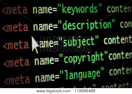 HTML meta tags in red light and dark green with mouse pointer