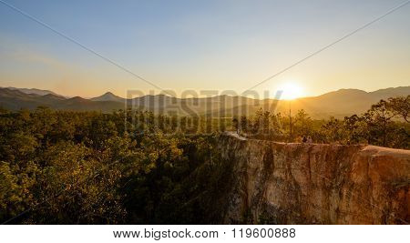 A beatiful sunset panorama with two hikers at Pai Canyon (Kong Lan) Maehongson Northern Thailand