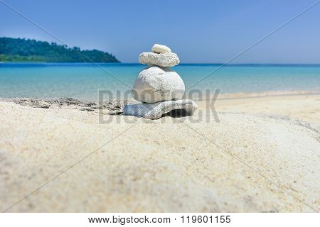 Stack Of Pebbles On White Sand At The Beach - Corals Rock With Wonderful Ocean View