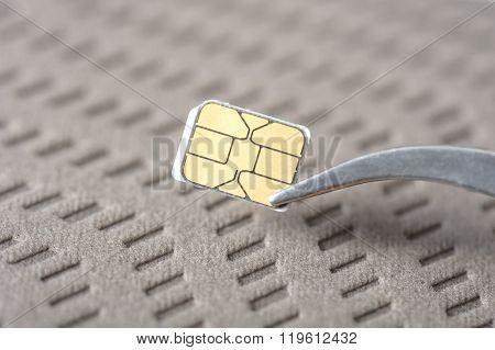 closeup very small Nano SIM card for smart phone