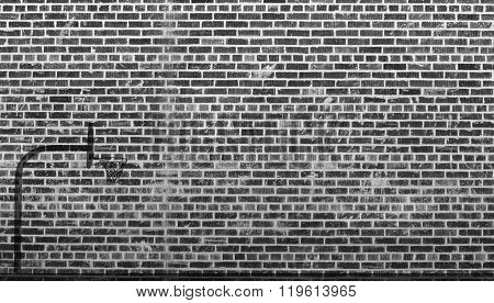 Basketball hoop - Basketball hoop shadow in front of brick wall in black and White