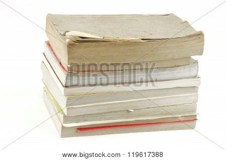 stacking old books on white background