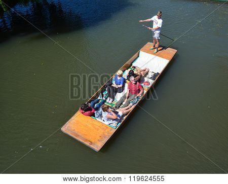 People in a punt on the river Cam at Cambridge.