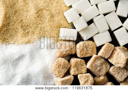 top view of unrefined cane and white sugar