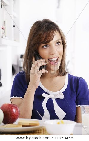 Young Woman Using Telephone