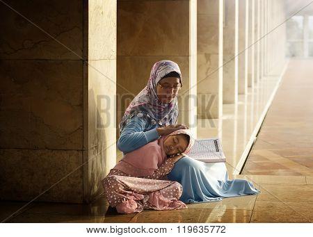 Muslim Mother Teach Her Daughter Reading Koran