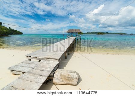 Tourist Resort And Jetty On Scenic Tropical Beach In Indonesia