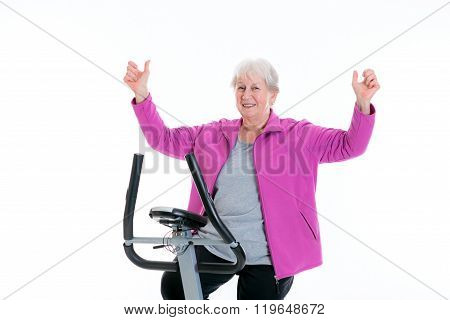 Female Senior With Arms Up Train With Fitness Machine