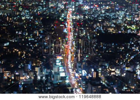 Abstract blurred bokeh lights aerial view city road