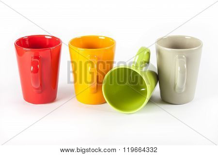 Four Color Tea Cups Shown In Row