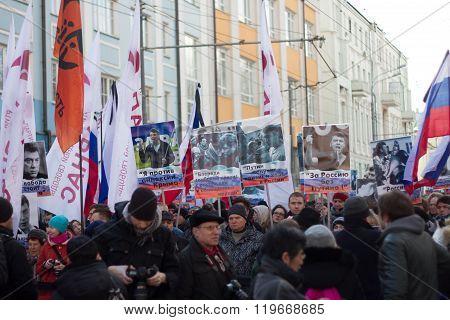 Portraits Boris Nemtsov at the memorial march