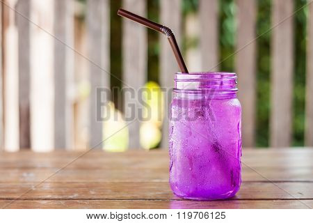 Iced Drink In Violet Glass In Coffee Shop