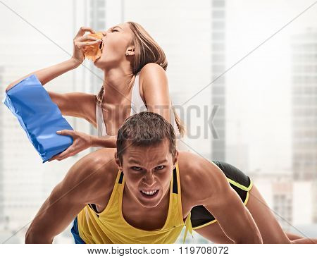 man doing push ups but woman eating