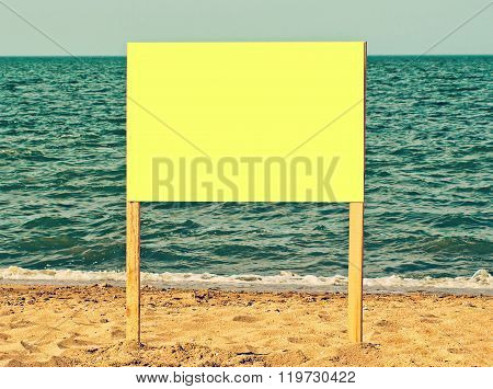 Yellow Blank Billboard On Sandy Beach.just Add Your Text.