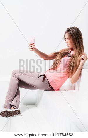girl doing selfie on mobile phone