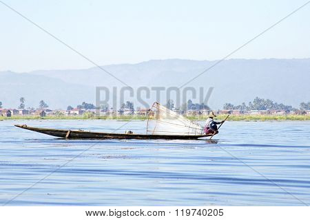 INLE LAKE, MYANMAR - November 15, 2015: Intha people possess  the unique coop-like fishing equipment