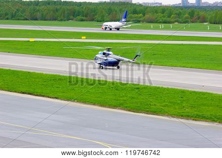 The Mil Mi-8Ps  Helicopter And Sas Scandinavian Airlines Boeing 737-683 Aircraft  In Pulkovo Airport
